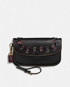 434445a6d6 clutch in coach link glovetanned leather Coach Saddle Bag