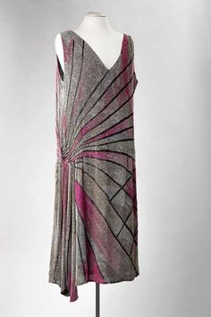 Evening dress, circa 1925-1926. Black silk crepe georgette with pink, white, and blue glass beads.