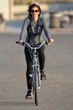Cindy Crawford makes activewear look chic on a late-afternoon bike ride.