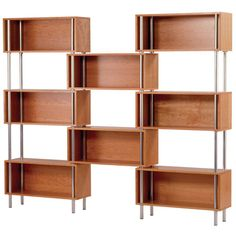 Display cherished travel mementos or your favorite reads in contemporary style with this sleek bookcase, featuring 8 cherry-finished storage cubbies set in a...