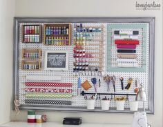 Is your craft closet unmanageable and overflowing? Frame a pegboard with some crown molding and add hooks to store craft supplies simply and elegantly. Get the tutorial at Honey Bear Lane.   - CountryLiving.com
