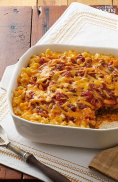 """Taco Bake prepared KD; cooked taco meat: sour cream; shredded cheese; salsa. Combine KD & Sour cream; layer in 8"""" baking dish with meat & cheese & salsa.  Bake 400 for 20-30 mins till cheese melted"""