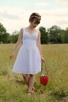 Voodoo Vixen white Billie Blush dress and Collectif strawberry bag