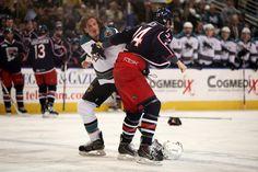 Worcester Sharks defenseman Taylor Doherty fights Springfield Falcons defenseman Brett Ponich (Nov. 15, 2014).