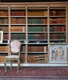 Charleston, the country home of the writers, painters and intellectuals known as the Bloomsbury group. Decorated by Vanessa Bell and Duncan Grant.  Clive Bell's library at Charleston.