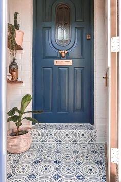 Blue front door with stencilled tile porch floor and bee knocker - Blue front door with stencilled tile porch floor and bee knocker - Painted Porch Floors, Painted Concrete Porch, Painted Front Porches, Concrete Front Porch, Porch Tile, Porch Paint, Front Door Porch, Small Front Porches, Porch Flooring