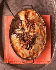 Potato-Mushroom Pie This gratin combines two comforting ingredients to their mutual advantage -- and ours. Sliced potatoes encircle a casserole dish, with assorted wild mushrooms, such as chanterelle and oyster, taking spots alongside more potatoes. Fresh thyme gives the pie herbal undertones; Gruyere and Parmesan, melting in and around the layers during baking, make it soul-satisfying.