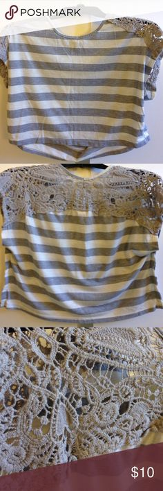 Shoulder Laced, gray and white striped belly top Size x-small belly top. This fits like a size small. It is in good condition but worn. No holes, pulls or stains on it. Tops Crop Tops