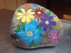 Beautiful flowers painted on stone!