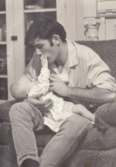 Elvis and baby Lisa. Elvis amazed everyone with his fatherhood skills. It just came natural.