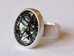 Tourmalinated Quartz Ring by Sam Woehrmann: http://www.moderneden.com/collections/all-collections/products/tourmalinated-quartz-ring