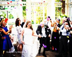 June wedding at Syon Park - photograph in the Great Conservatory with confetti