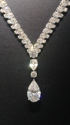 Magnificent De Beers Phenomena Reef necklace with and 8.49 carat pear cut diamond.