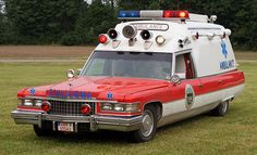 Cadillac red body white hood ambulance