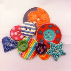 Hand crafted, hand glazed ceramic buttons, Magpie  Butterfly.  Hand-crafted boutique buttons from Cornwall
