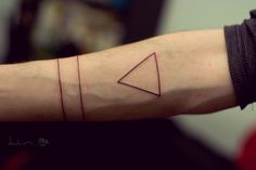 I like this. I originally saw it as a triangle and two bands, but another pinner pointed out that the bands could actually be circles that go around the arm (because they are technically). Could easily be a pagan tattoo.