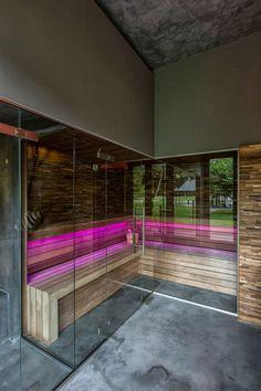 Sauna with pink lights.
