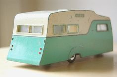 Vintage 1960s Collectible Retro Diecast Dinky Caravan Camper RV Trailer in Turquoise and Cream for Summer Camping Vacation.