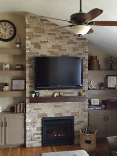Airstone fireplace with Regency insert and floating shelves for our living room. Finally finished and we love our results after a lot of hard work!