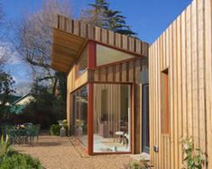 wrapped timber house in the norfolk broads by forrester architects