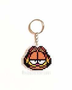 Mmmmm......lasagne.... A fun #Garfield keychain I made this week so far. I'm working on stocking up as much as possible for a project I have coming up in November so expect a lot of new stuff in the next few weeks!  As always I will list this up on my #Etsy shop for anyone who's like to have one of their own later tonight!  stay tuned for more! by badgercreations