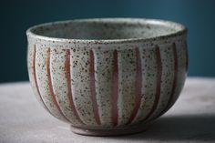 stoneware bowl.  cone 10 reduction. shino wash/wax/white liner.  heidi haugen pottery