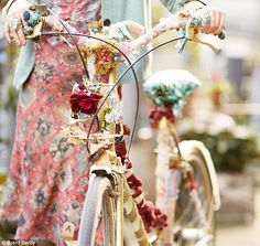 Emma with her vintage bike adorned with offcuts of Bennison Fabrics and decorations bought at car-boot sales