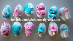 Confetti bebè. Decorazioni realizzate a mano, in pasta di zucchero. Handmade Info: leminicakedialeta@gmail.com  www.leminicakedialeta.wordpress.com