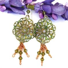 """The beautiful """"Filigree Fancy"""" handmade Victorian inspired earrings were created with artisan hand painted green brass filigree components, olivine Swarovski crystals, copper and sterling silver -  unique jewelry for women."""