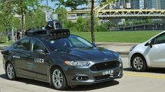 A prototype self-driving car based on a hybrid Ford Fusion and developed by the Uber's Advanced Technologies Center (ATC) in Pittsburgh. Credit: Uber