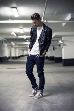 Try pairing a black leather biker jacket with dark blue jeans to get a laid-back yet stylish look. Feeling brave? Complete your look with grey high top sneakers.  Shop this look for $59:  http://lookastic.com/men/looks/black-biker-jacket-white-crew-neck-t-shirt-navy-jeans-grey-high-top-sneakers/7464  — Black Leather Biker Jacket  — White Crew-neck T-shirt  — Navy Jeans  — Grey High Top Sneakers