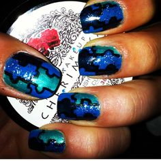 My Autism Awareness blue puzzle nails :) 1st create a checker pattern on nails with whatever colors you would like 2 using your large dotting tool add dots along the edges to make puzzle effect then I outlined the puzzle pieces with black then added two coats Seche Vite :)