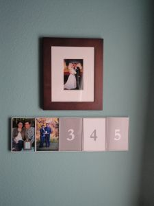 Anniversary pictures display in master bedroom