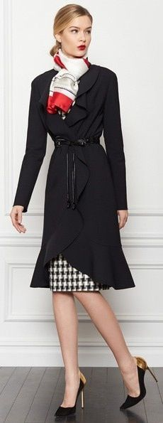 Unique business suit by the inimitable Carolina Herrera.