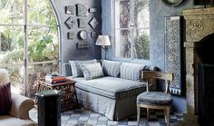 Love the tonal shades of blue in this rustic, cozy living room corner.