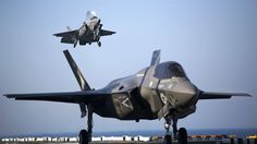 Two F-35B Lightning II Joint Strike Fighters complete vertical landings aboard the USS Wasp (LHD-1) during the opening day of the first session of operational testing, May 18, 2015 - via http://www.marines.mil/News/NewsDisplay/tabid/3258/Article/611657/us-marines-corps-declares-the-f-35b-operational.aspx