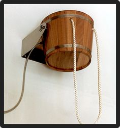 """DOUSING BUCKET KAMBALA  18 litre in larch wood. Holder made of stainless steel, ceiling or wall assembly. Inside coated with watertight varnish, outside with clear varnish, pull chain 700 mm length with toggle lever, quick connector 1/2"""", adjustable float valve. Weight 6,2 kg."""