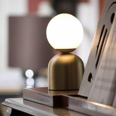 The Inteuri Light Bonbon Table Lamp is sweet and petite, the handspun metal design and glass globe shade allow for a warm, glowing effect while also adding modern flavor to your shelf or tabletop vignettes. #modernlighting #tablelamps #lighting #inteurilight