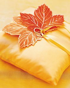 Embossed velvet leaves dress up a silk ring pillow