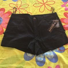Black shorts Rampage black cotton shorts, size 11.  Really cute sticking and pockets.  New tag attached. Rampage Shorts