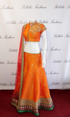 Palkhi Fashion exclusive Orange full flair Silk Lehenga With Unique Style Blouse.
