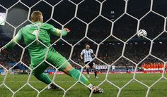 Argentina's Messi shoots to score his penalty past Cillessen of the Netherlands during their shootout in their 2014 World Cup semi-finals at the...
