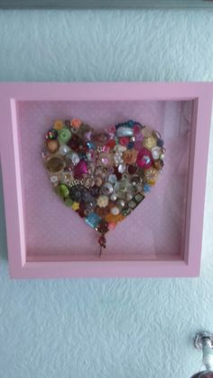 Heart picture made from broken jewellery.