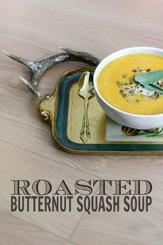 Thick and creamy roasted butternut soup dressed up with sage, toasted pumpkin seeds, and a hit of spice.