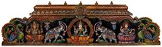 The wooden panel you see on this page is a symbol of auspiciousness, moulded stylishly in varied patterns and designs that enhance the beauty of its carve; the top layer is smoothly curved followed by a layer of lotus petals and a check pattern as a filler to the background. The cosmic triad of lord Ganesha, goddess Lakshmi and goddess Saraswati is carved in their run-of-the-mill postures on full blooming lotus pedestals blessing the devotees of good health, wealth, wisdom and fearlessness. Hindu Statues, Christmas Village Display, Indian Temple, Goddess Lakshmi, Lord Ganesha, Sculptures, Carving, Blessing, Cosmic