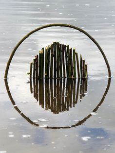 """""""Land Art: By using the surface of a lake as a mirror, Ludovic Fesson tries to reflect the grace of nature. Land Art, Reflection Art, Water Reflections, Art Environnemental, Art Et Nature, Ephemeral Art, Art Sculpture, Metal Sculptures, Abstract Sculpture"""