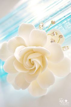 Now offering these gardenia hair flowers with handwired rhinestone sprays. You get to pick the color of the flower and the setting.