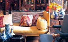 library of interior designer Michael Smith...love the couch with cushions in both Indian fabrics and Turkish ikat.