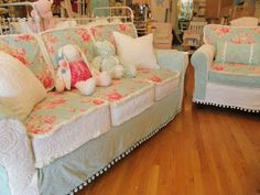 i made these slipcovers using vintage chenille bedspreads and reproduction roses fabrics aqua white www.vintagechicfurniture.com