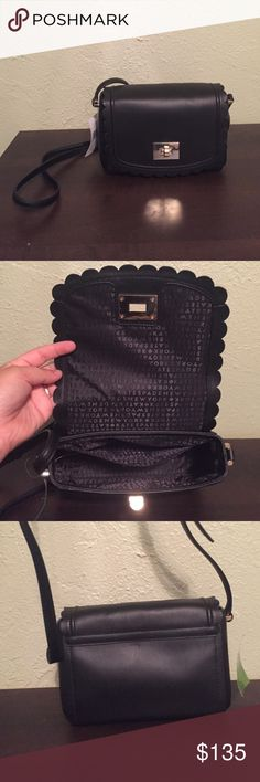 "NWT Kate spade cross body NWT Kate spade cross body in black. Absolutely beautiful with a scalloped edging and a turn lock to keep your items secure. Approximately 8"" L 5"" T and 3.5"" W. No trades and please use offer button. kate spade Bags Crossbody Bags"